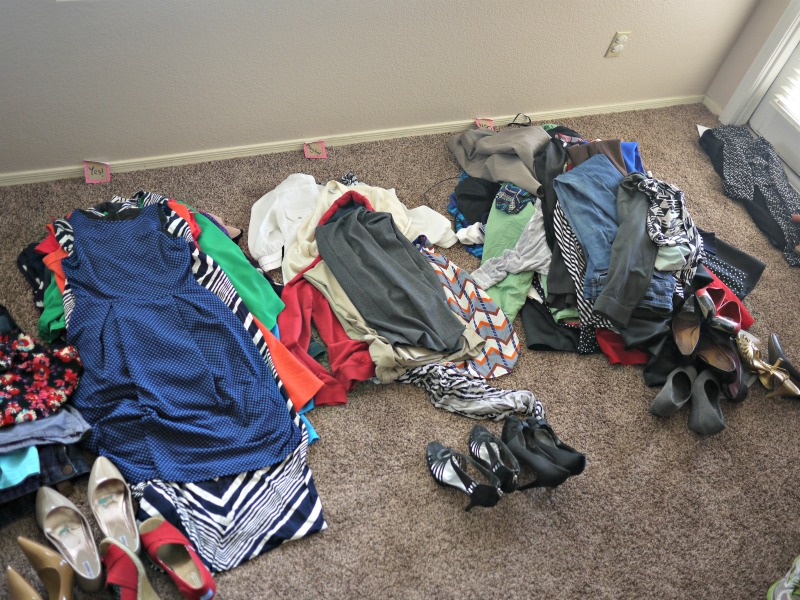 Sort clothes into four piles to create your small wardrobe: Yes, Maybe, No, Seasonal