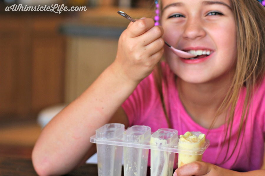 girl-eating-pudding-pop-spoon