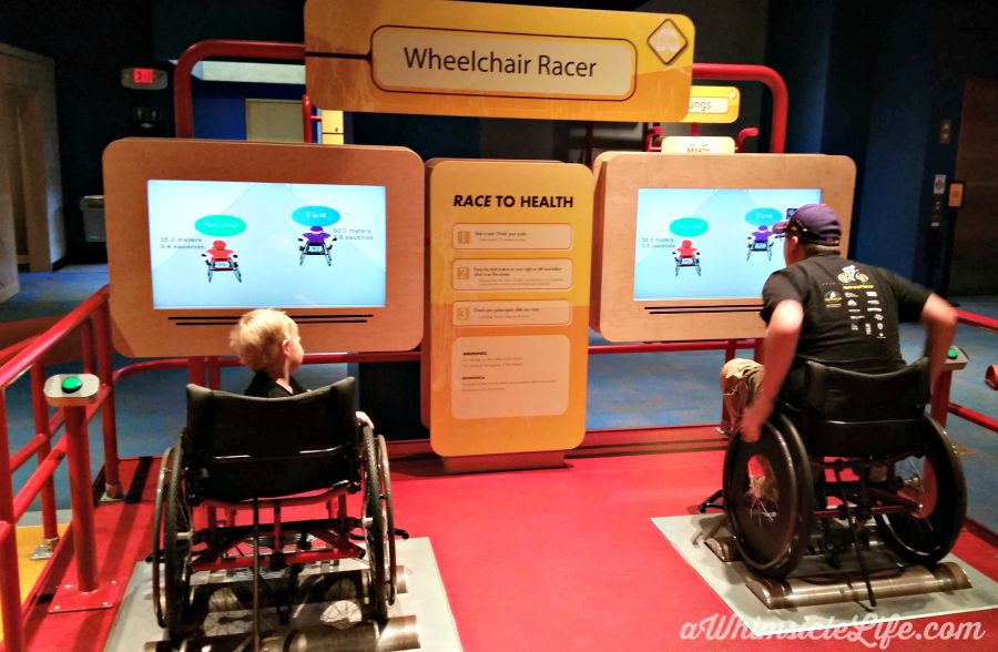 Father and 2-year-old Son wheelchair racing at Arizona Science Center