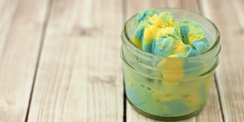 Blue and yellow minion ice cream in a mason jar.
