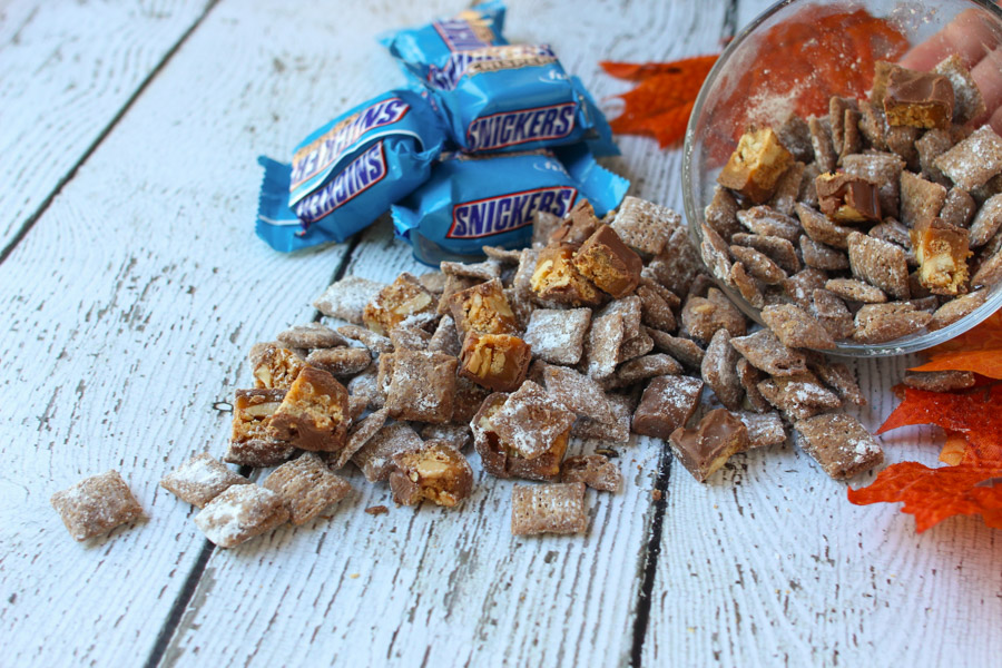 Perfect fall snack! SNICKERS®Crisper puppy chow makes a great football party food, sweet recipe or easy dessert.