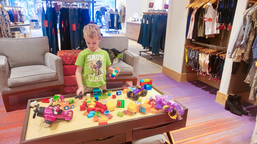 Kids play area while you shop for stylish mom outfits.