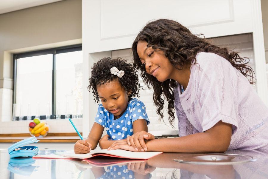 Mom helping kid with elementary school homework.