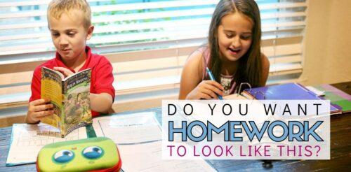 Two elementary school kids happily work on homework