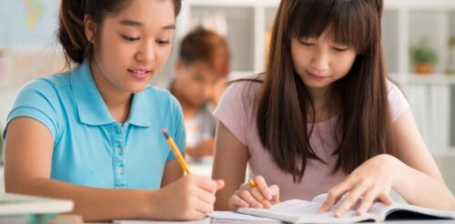 Two girls working on a school assignment