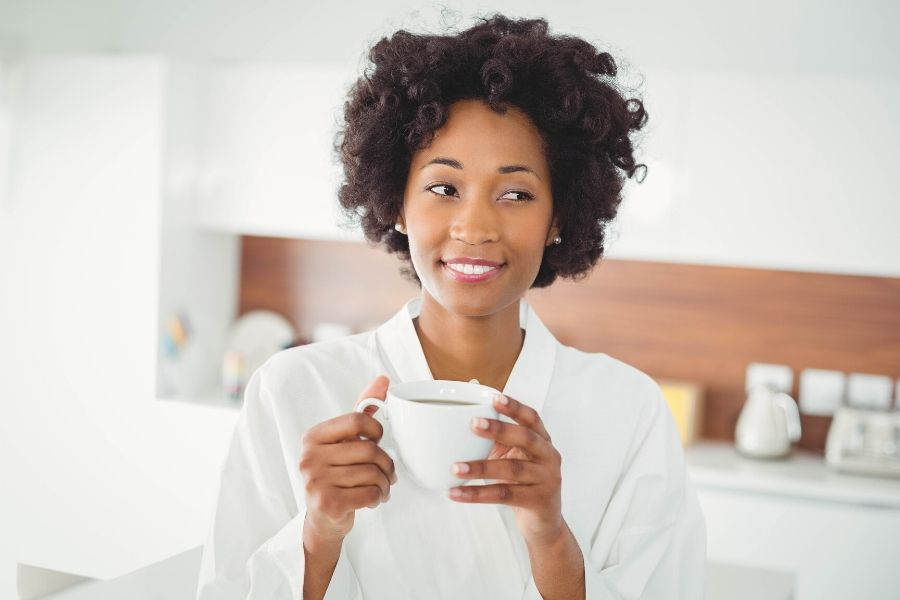 Woman holding cup of coffee and relaxing